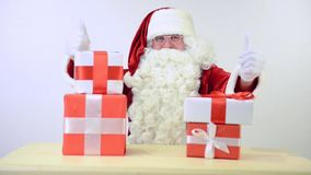 Santa Claus with gift boxes stock video footage