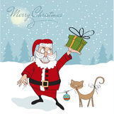 Santa Claus with gift Stock Photos