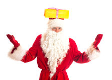 Santa Claus with gift on his head. Royalty Free Stock Image
