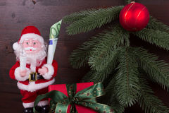 Santa Claus with gift of money in his hand Royalty Free Stock Images