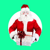 Santa Claus with gift posing on color white green. Santa Claus with gift posing on white green background Stock Photography