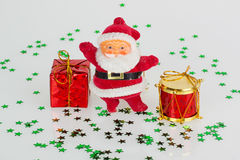 Santa claus with gift and red drum Stock Photography