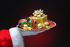 Santa Claus With Gift on Tray Royalty Free Stock Photography