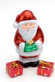 Santa claus and gifts. Santa claus figure with two wrapped presents stock photo