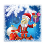 Santa Claus with gifts on blue Stock Photography