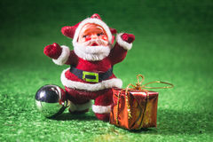 Santa Claus with gifts box. Santa Claus with gifts box on green background Royalty Free Stock Photo