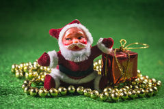 Santa Claus with gifts box. Santa Claus with gifts box on green background Stock Photography