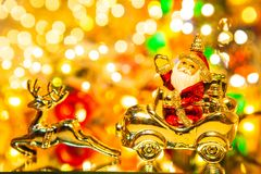 Santa Claus with gifts on car with christmas deer, on bokeh backg stock photography