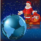 Santa Claus with gifts and earth Royalty Free Stock Photos