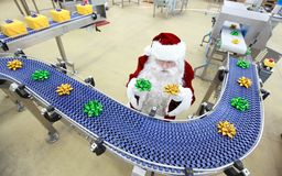 Santa claus in gifts factory  - assembly line Royalty Free Stock Images