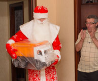 Santa Claus with gifts and grandfather surprised Royalty Free Stock Image