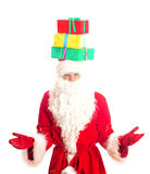 Santa Claus with gifts on his head. Stock Photo
