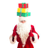 Santa Claus with gifts on his head. Stock Photography