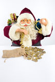Santa Claus with gifts and money coins Stock Image