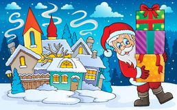 Santa Claus with gifts in winter scenery Stock Image