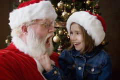 Santa Claus With A Girl Stock Photo