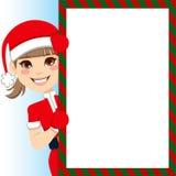 Santa Claus Girl. Pretty Santa Claus Girl peeking out of big blank billboard sign Stock Image