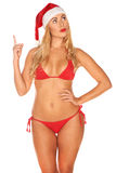 Santa Claus girl in a bathing suit Royalty Free Stock Images