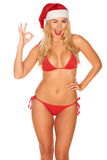 Santa Claus girl in a bathing suit Royalty Free Stock Image