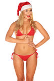 Santa Claus girl in a bathing suit Stock Image