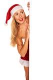 Santa Claus girl behind board Stock Photos