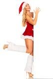 Santa Claus girl behind board Royalty Free Stock Images