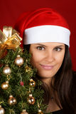 Santa Claus girl with Christmas tree Royalty Free Stock Photo