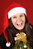 Santa Claus girl with Christmas tree Royalty Free Stock Photos