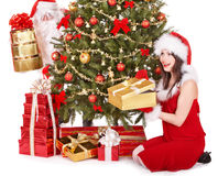 Santa claus and girl by christmas tree and gifts. Royalty Free Stock Photo