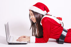 Santa claus girl. With computer Stock Image