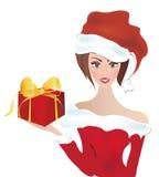 Santa Claus Girl. Fröcken Santa With per en hatt och gåva Arkivfoton