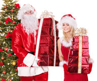 Santa claus, girl with gift box by christmas tree. Stock Photo
