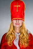 Santa Claus Girl with hat in her face Stock Images