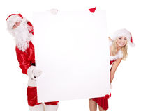 Santa claus and girl holding banner. stock photo