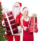 Santa claus and girl holding  gift box. Stock Images