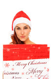 Santa claus girl holding a shopping bag Stock Photo