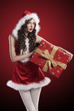 Santa claus girl with huge red gift box Stock Image