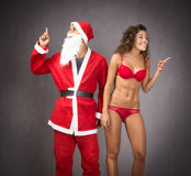 Santa claus with girl indicated something Royalty Free Stock Images