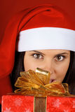 Santa Claus girl offering Christmas present Royalty Free Stock Images
