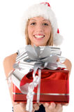 Santa Claus Girl Offers A Gift Royalty Free Stock Photography