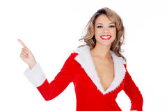 Santa Claus girl presenting something and pointing Royalty Free Stock Photos