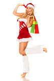 Santa Claus girl with purchases Stock Image