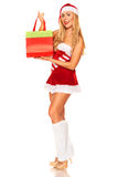 Santa Claus girl with purchases Stock Photo
