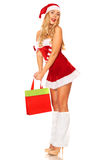 Santa Claus girl with purchases Royalty Free Stock Image