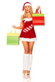 Santa Claus girl with purchases Royalty Free Stock Photo