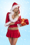 Santa claus girl with red gift box Stock Images