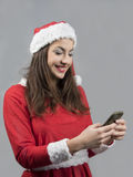 Santa claus girl sending christmas greatings stock images