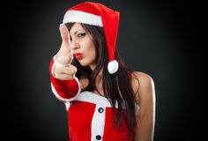 Santa claus girl shooting with hand Royalty Free Stock Photography