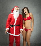 Santa Claus and girl unbelievable faces Royalty Free Stock Photography
