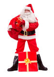 Santa Claus give Christmas gifts Stock Photos